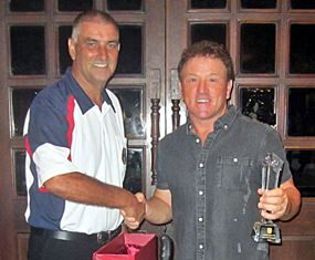 2015 Club Champion Paul Smith (right) is congratulated by PSC Golf Chairman Mark West.