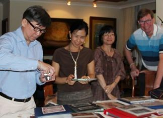 (L to R) Museum Specialist Sanchai Wongsarawanee, Team Executive Sumaivadee Merkasut, Senior Curator Suwapak Piriyapolkai and Jan Olav Aamlid studying the collection of artwork, master banknotes and specimens of Thai banknotes.