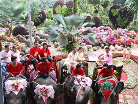 At Nong Nooch Tropical Garden, 79 couples rode their way into matrimony on the back of elephants.
