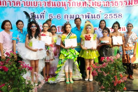 "Winners of the ""Miss Recycle"" contest collect their rewards."