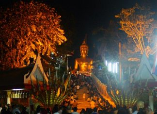 "Pattaya Buddhists, shown here on ""Buddha Hill"" (Wat Khao Phra Yai) during last year's event, will merit and parade with candles as the area celebrates Makha Bucha Day, one of the holiest days on the Buddhist calendar."