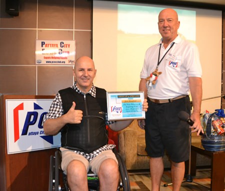 PCEC Chairman Roy Albiston presents Jens Maspfuhl with the Club's Certificate of Appreciation for his inspiring story about becoming a paraplegic and how he went on to have an active and meaningful life.