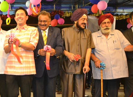 The ribbon cutting ceremony, (l-r) Mayor Itthipol Khunplome, Peter Malhotra, P.S. Grover and Amrik Singh, Head of the Thai Sikh community in Pattaya.