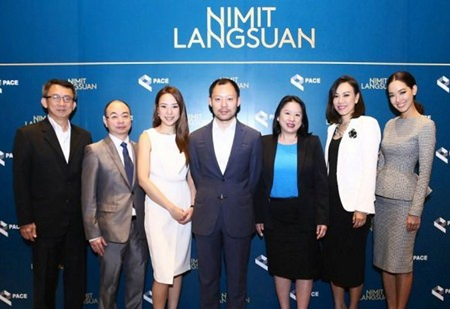 Sorapoj Techakraisri (centre), CEO of PACE Development Corp., stands with fellow company directors and management during the announcement of the Nimit Langsuan project in Bangkok, Feb. 26, 2015.