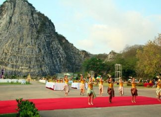 Young Thai dancers perform in front of the Khao Chi Chan Engraved Buddha Image during the annual Makha Bucha Day carving ceremony to preserve the image. People throughout the Kingdom flocked to local temples to commemorate the occasion when 1,250 disciples traveled to meet with Lord Buddha with no prearranged agreement at Weluwan Mahawiharn Temple in the area of Rachakhryha, India.