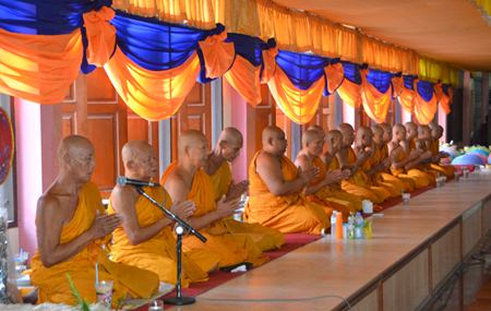Phra Kru Wijarn Thammakit, aka Luang Pu Maha Sombat (far left) and monks at Khao Makok temple perform a prayer service on Makha Bucha Day.