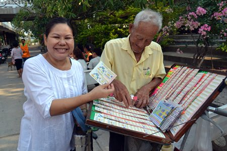 People are able to buy lottery tickets at their temples after they make merit.