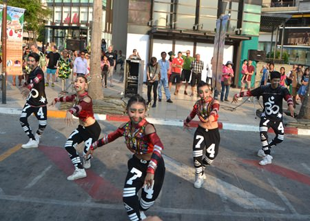 Dancers from school number 11 entertain the crowds at Central.