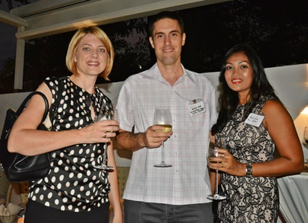(L to R) Kate Gerits, General Manager of Holiday Inn Pattaya; Nicolas Duke, General Manager of Air International Thermal Systems (Thailand) Ltd.; and Wasana, also from Air International Thermal Systems, exchange stories about living in Thailand.