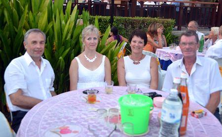 (L to R) Johs Stokkeuas, Solveig Stokkeuas, Turid Eksund and Oddgeir Sanclo enjoy the anniversary party.