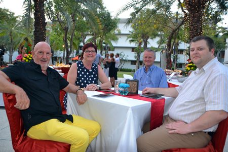 (L to R) Noel Wittoeck, Marina Slabaer, Danny D'Hooghe, and Ward D'Hooghe sample the wines on offer during the monthly 'Wine Experience' in the garden between the Amari's Garden Wing and the new Tower.