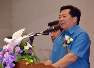 """Chonburi PAO President Wittaya Kunplome presides over the """"Together Caring For Citizens"""" project at the Eastern National Indoor Stadium."""