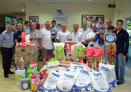 TFi are joined by sponsors and Derek Franklin and Father Peter for the donation of goods.
