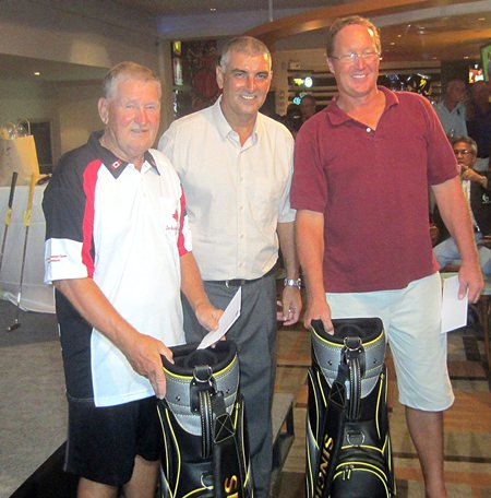 PSC Golf Chairman Mark West (centre) presents prizes to tournament winners Daryl Tomlinson & Darren Zuidema.