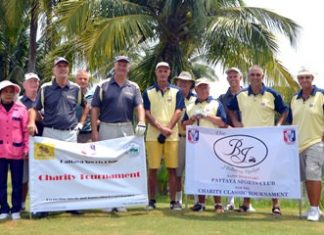 Tournament organizers, players and caddies pose for a group photo at Burapha Golf Resort.