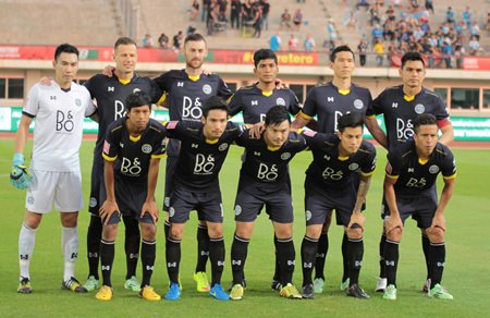 Pattaya United FC line up before their Thai League Division 1 fixture against Thai Honda FC at the 72nd Anniversary Stadium in Bangkok, Sunday, March 1.