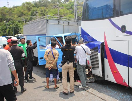 Surat Thai-oun and passenger Worachai Sripanoun were pinned in their truck when it slammed into the back of a tour bus.