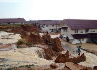Poorly designed and constructed flood prevention measures in this housing development gave way, creating a landslide and a dangerous situation for residents.
