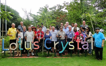 PCEC members and guests on a day trip pose in front of the sign for the glass factory they visited on their way to Rayong's famous Fruit Farm.