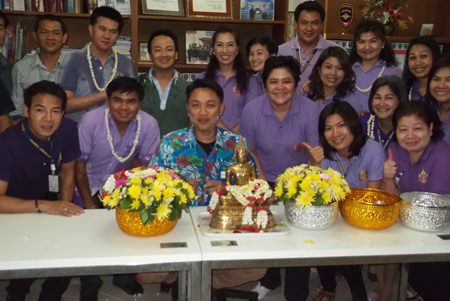 "Relatives and family members of immigration officials were invited to join the ""rod nam dum hua"" ceremony at the Chonburi Immigration Office in Jomtien."