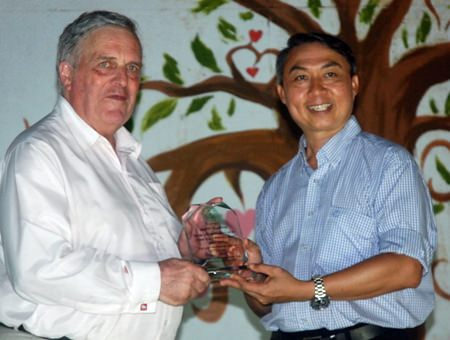 Father Peter presents Andrew Scadding from the Thai Children's Trust with a personal award of appreciation.