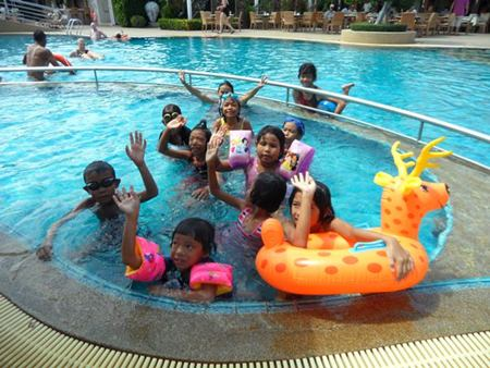 The children enjoy playing in the big pool.