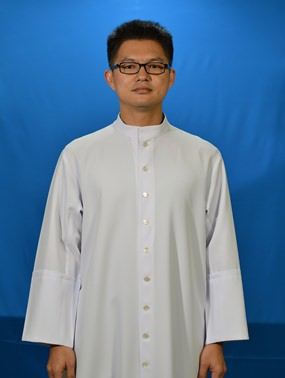 Fr. John in his official pose as a priest.