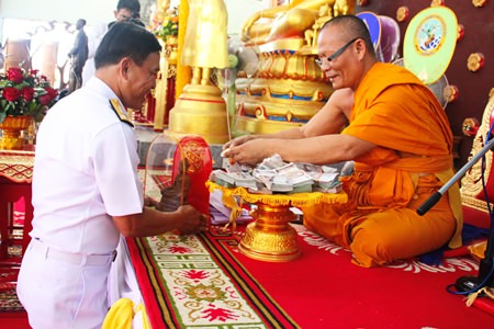 "Rear Adm. Jongkol Meesawad presents a million baht to Abbot Sangkakarn Buraphathid for construction of a main hall at Sattahip's Wat Pa Yup in the name of the ""Father of the Thai Navy."""