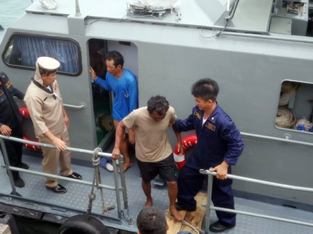 The Royal Thai Navy brings ashore fishermen who floated in the sea for 18 hours after their boat sank.