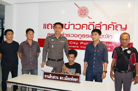 """Pairoj Noypratum, claiming to be """"mafia"""", has been arrested for stabbing a rival with a small knife, which he holds up for the media."""