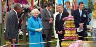 Queen Elizabeth II visits the Nong Nooch Tropical Garden's floral display in London.