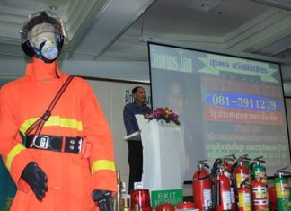 Pattaya's Disaster Prevention and Mitigation Office Chief Surapol Sawadvichien teaches basic fire safety at the Royal Cliff.