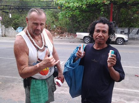 Gerry helps out a homeless Thai man.
