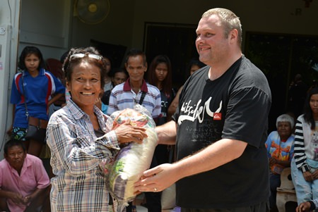 TFi team member Matt O'Sullivan helps distribute the food parcels.