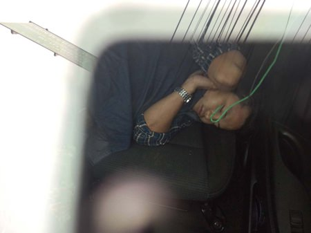 Police couldn't wake Pornchai Wongtam so they left him inside his car whilst they towed it to the police station.