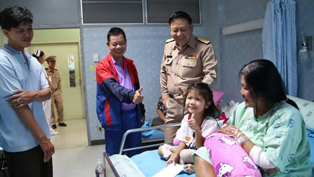 Young Miss Patidtha, after having one of her legs amputated as a result of a horrific crash, puts on a brave face, giving thumbs up to the visiting entourage.