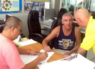 Tom Henning Bruvold (center) said he had not intended to stay in Thailand longer than his visa allowed, but he had run out of money.