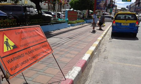 The condition of the road in front of Friendship Supermarket is worsening.