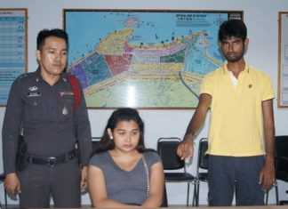 Ladyboy Jakree Sawatnathee (seated) was caught in the act of snatching a gold necklace from Indian tourist Srikanth Jayprakash.