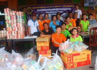Members of Lions Club International District 310 C prepare to pack over 1,000 bags of rice and dried food to help flood victims in Tabma, Rayong.