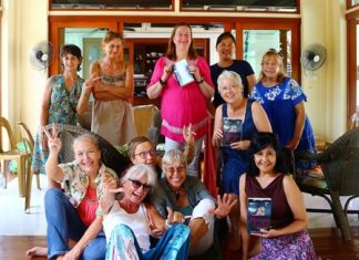 "Pattaya Book Group members pose with copies of Daniel M Dorothy's ""Mango Rains' at their monthly meeting on September 29."