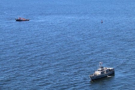 Helicopter crews and divers took a final shot at finding four crewmen of a containership that sank near the mouth of the Chao Phraya River, but failed to find their bodies.
