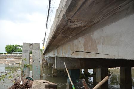 Naklua's bridge is in need of urgent repair, as erosion has damaged the bridge's foundation.