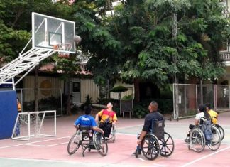 Students take part in a basketball game at the Redemptorist Vocational School in Pattaya, Friday, Oct. 2