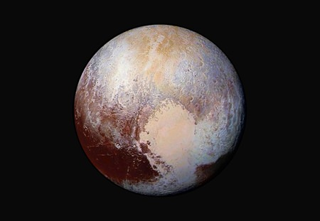 The New Horizons spacecraft was programmed to fire its thrusters Thursday, Oct. 22, 2015, putting it on track to fly past a recently discovered, less than 30-mile-wide object out on the solar system frontier. The close encounter with 2014 MU69 would occur in 2019. It orbits nearly 1 billion miles beyond Pluto (shown here). (NASA/JHUAPL/SwRI via AP)