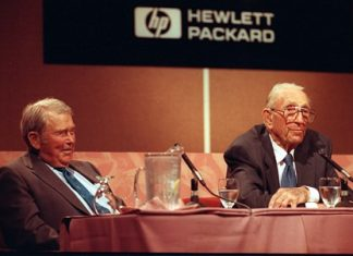 In this Sept. 17, 1993, file photo, David Packard, right, co-founder of the Silicon Valley computer company Hewlett-Packard, announces his retirement as chairman during a news conference at HP's headquarters in Palo Alto, Calif. Packard, 81, started the company in 1939 with William R. Hewlett, who listens at left. Hewlett-Packard, one of the nation's most storied tech companies split in two the weekend of Oct. 31, 2015, another casualty of seismic shifts in the way people use technology and big-company sluggishness in responding. (AP Photo/Joe Pugliese, File)
