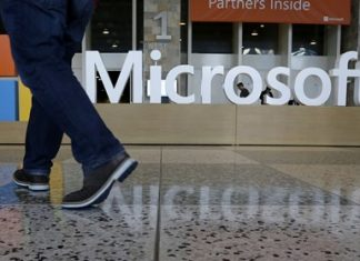 Starting next year, Microsoft will cut the free space it offers through its OneDrive service to 5 gigabytes, down from 15 gigabytes now. Microsoft says the new allotment is enough for about 6,600 Office documents or 1,600 photos. (AP Photo/Jeff Chiu, File)