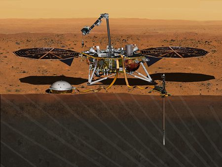 This August 2015 artist's rendering provided by NASA/JPL-Caltech depicts the InSight Mars lander studying the interior of Mars. The spacecraft, which is scheduled to launch for Mars in March 2016, has a leak that could delay the mission. On Thursday, Dec. 3, 2015, NASA said that the leak is in one of two prime science instruments. (NASA/JPL-Caltech via AP)