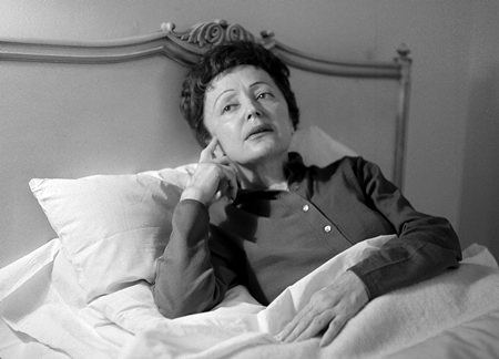 French songstress Edith Piaf props up in bed at the Waldorf-Astoria Hotel in New York in this Feb. 20, 1959 file photo. (AP Photo/Matty Zimmerman)