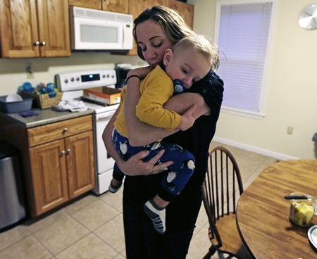 Cancer survivor Christine Ells embraces her twenty-month-old son Jameson after arriving home from work in Whitman, Mass. Ells, 36, a teacher in the Boston suburb of Quincy, developed a heart rhythm problem from several drugs she was given to treat the breast cancer she was diagnosed with at age 27. Certain cancer drugs, such as Herceptin and doxorubicin, sold as Adriamycin and other brands, can hurt the heart's ability to pump, and lead to heart failure. (AP Photo/Charles Krupa)
